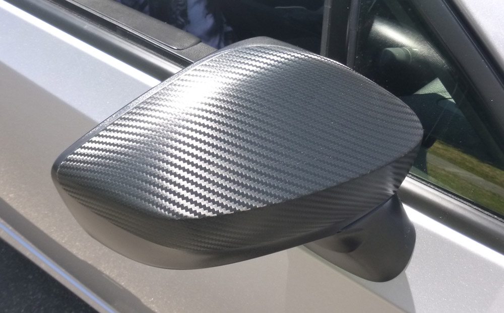 carbon-fiber wrap on mirror
