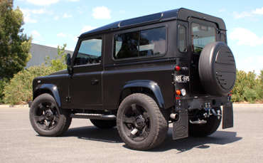 Satin black car wrap on Land Rover Defender