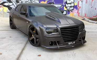 Chrysler 300c wrapped in Avery Satin Pearl Nero