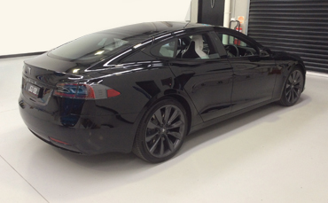Tesla Model S with chrome trim wrapped in gloss black 3M vinyl