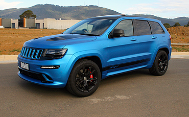 Jeep Cherokee wrapped in 3M matte metallic blue